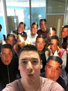 Stefan and the team, with their Stefan masks